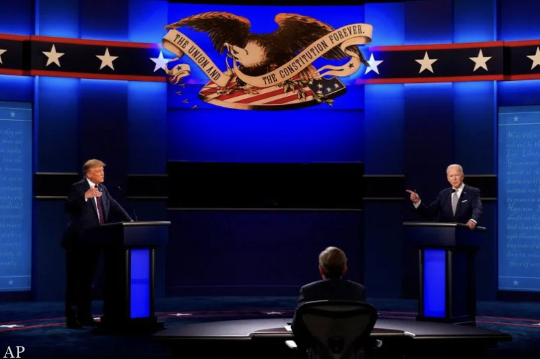 President Donald Trump and Vice President Joe Biden take the stage at first Presidential Debate (PHOTO CREDIT: deadline.com)