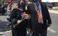 Ms. Takacs and Dr. Hodgson at last year's drive through graduation.