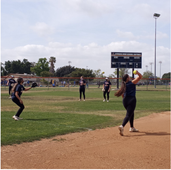 Softball team members warming up at practice on April 14, 2021.  Photo by Nevaeh Rangel