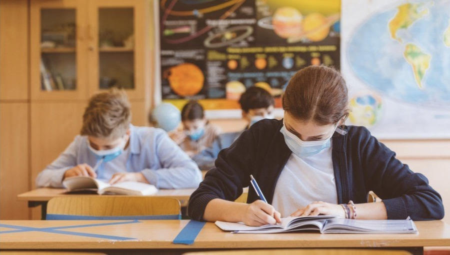 Despite returning to in person instruction, students will return to a very different school than the one they left. (Photo Credit: BBC)