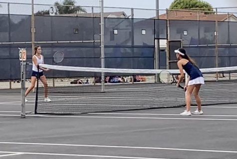 A player on the JV Girls Tennis Team battling it out this month on the new tennis courts.