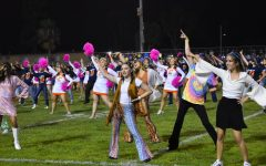 Dance, Cheer, Song and Choir give a high energy half-time performance during the game.